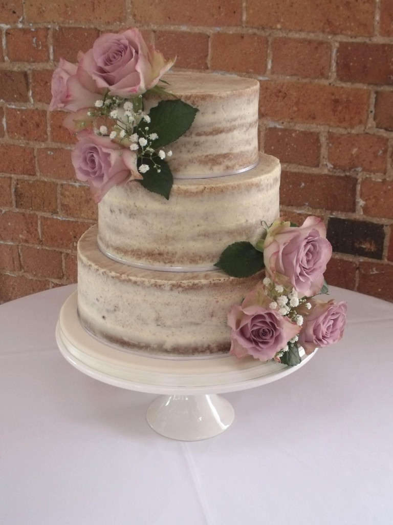 Semi-naked wedding cake by Helen Alborn Cakes