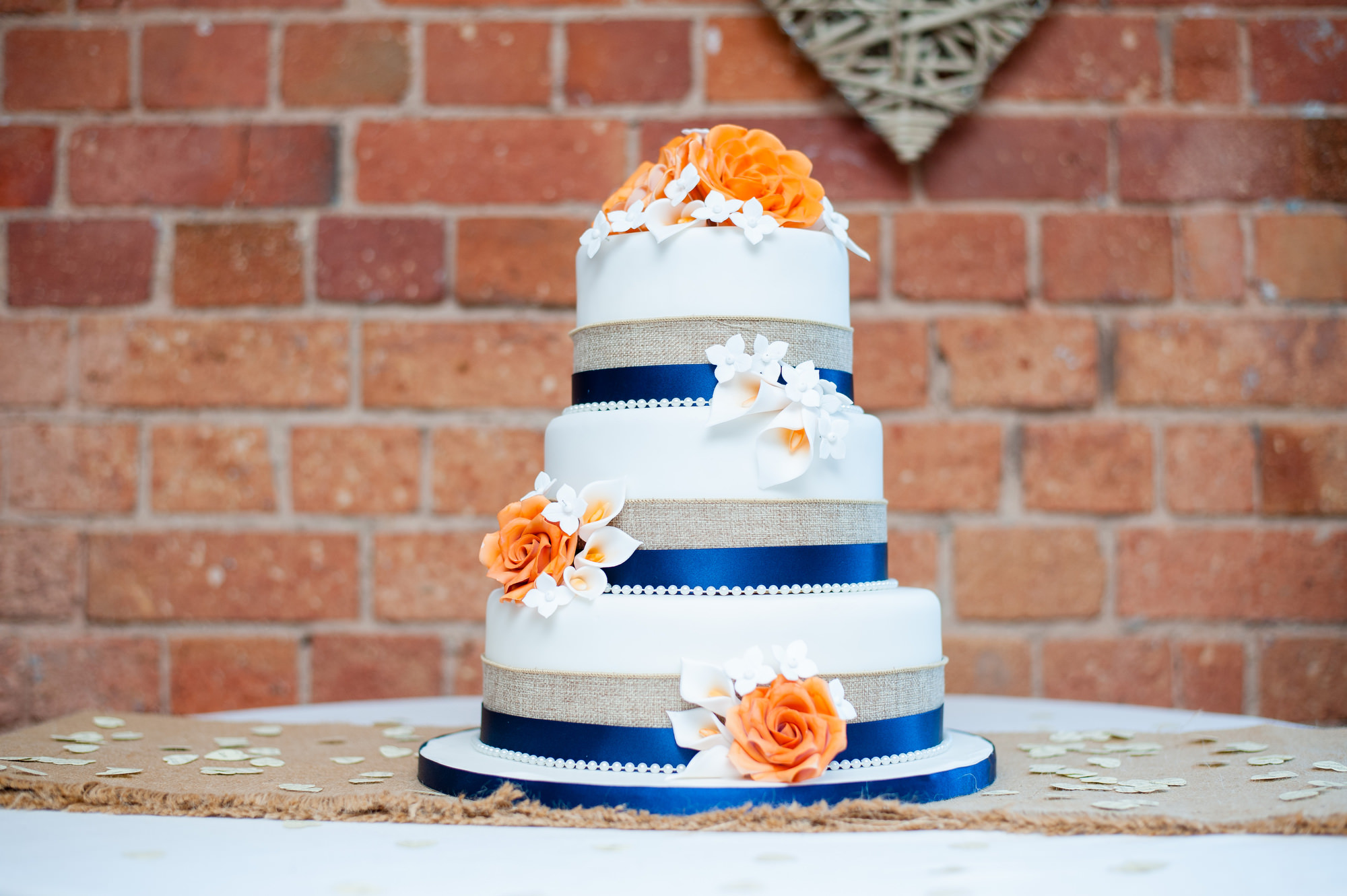 Orange And Blue Wedding Cake With Flowers
