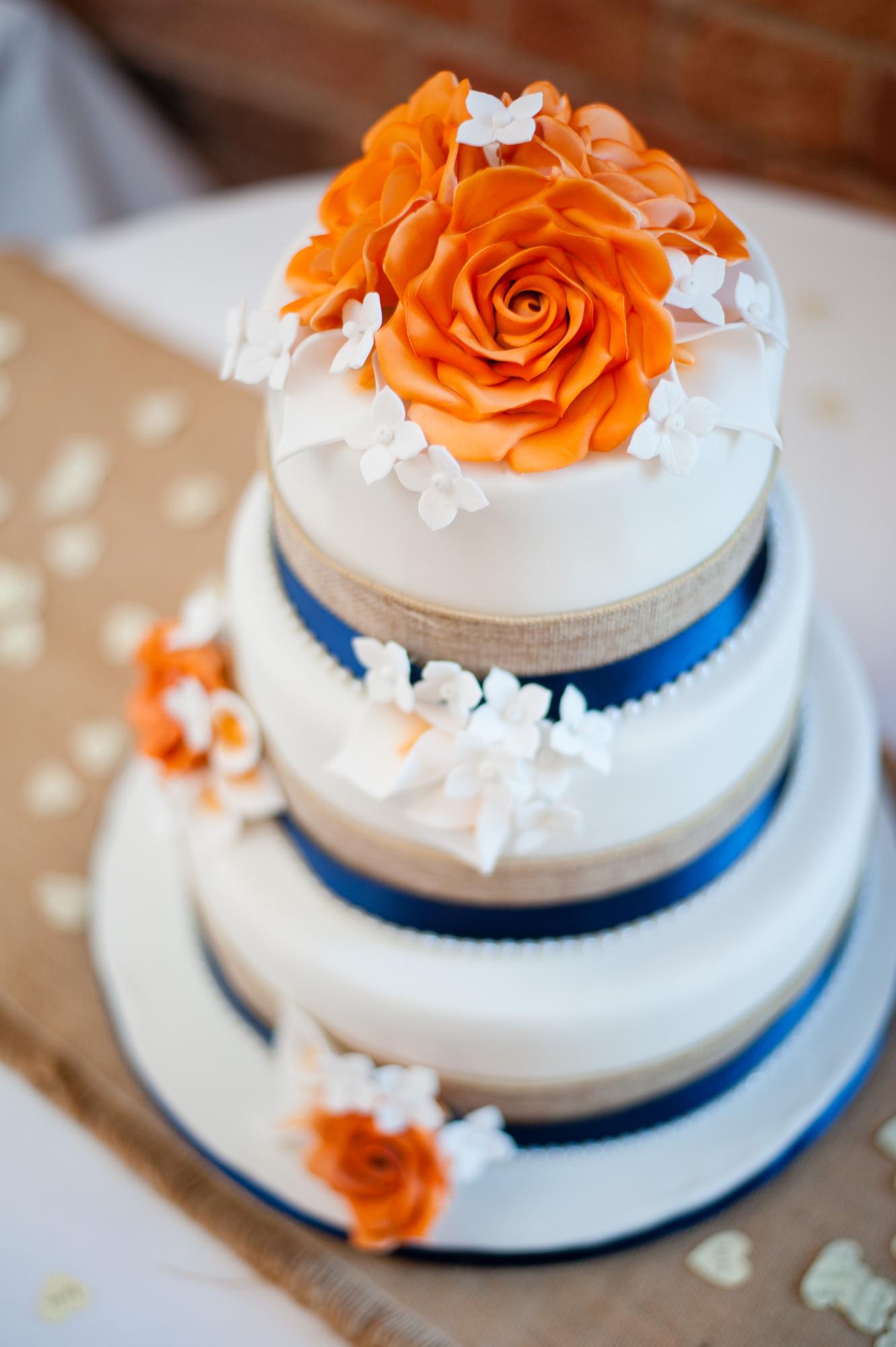 Orange And Blue Wedding Cake With Flowers