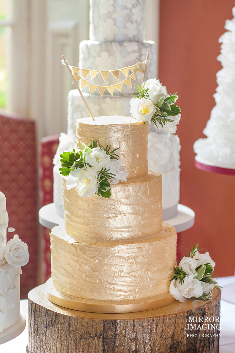 Gold 3 Tier Wedding Cake With Flowers