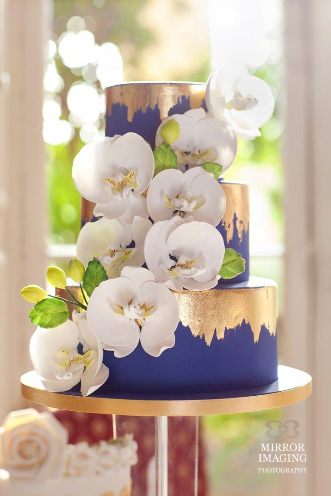 orchid wedding cake with gold leaf