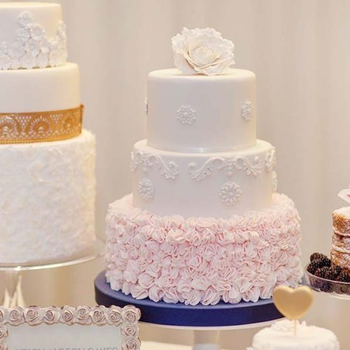 Selection Of Wedding Cakes In Pink And Gold