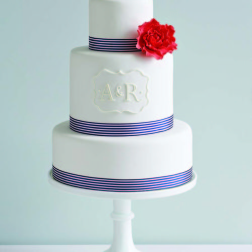 Wedding Cake With Red Flower And Blue Ribbon