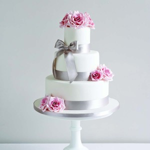 Wedding Cake With Silver Ribbon And Pink Flowers