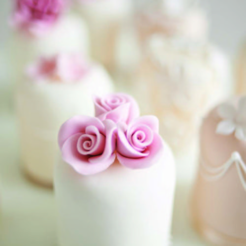 Elegant Iced Cupcake With Pink Roses