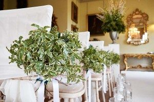 Pew ends along wedding aisle at Prestwold Hall Leicestershire
