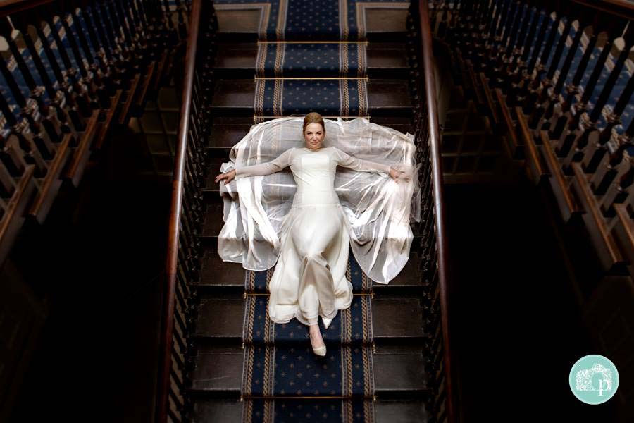 Bride Posed On The Stairs - Oehlers Photography | Nottingham Wedding Photographer
