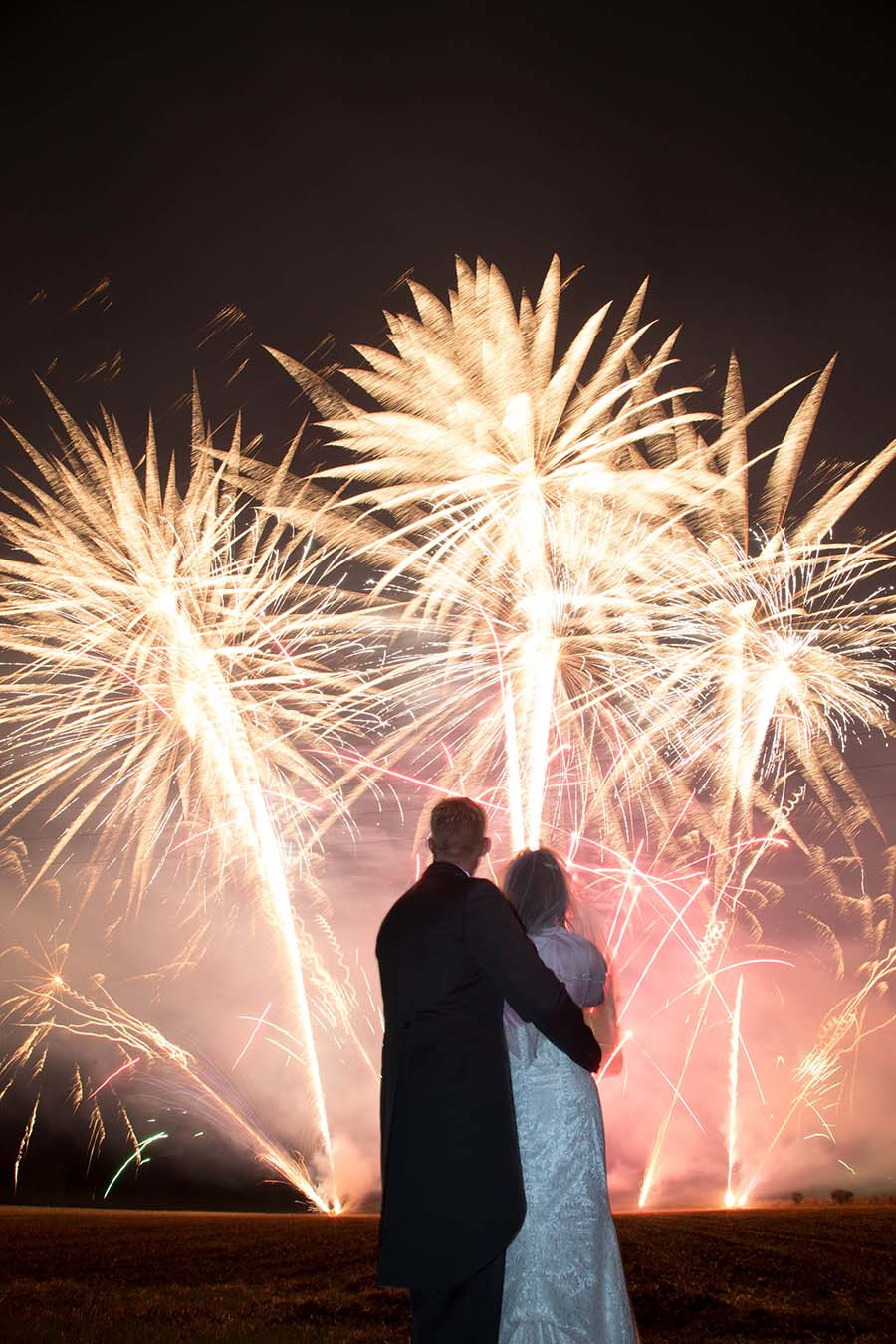 Bride And Groom Watching Wedding Fireworks