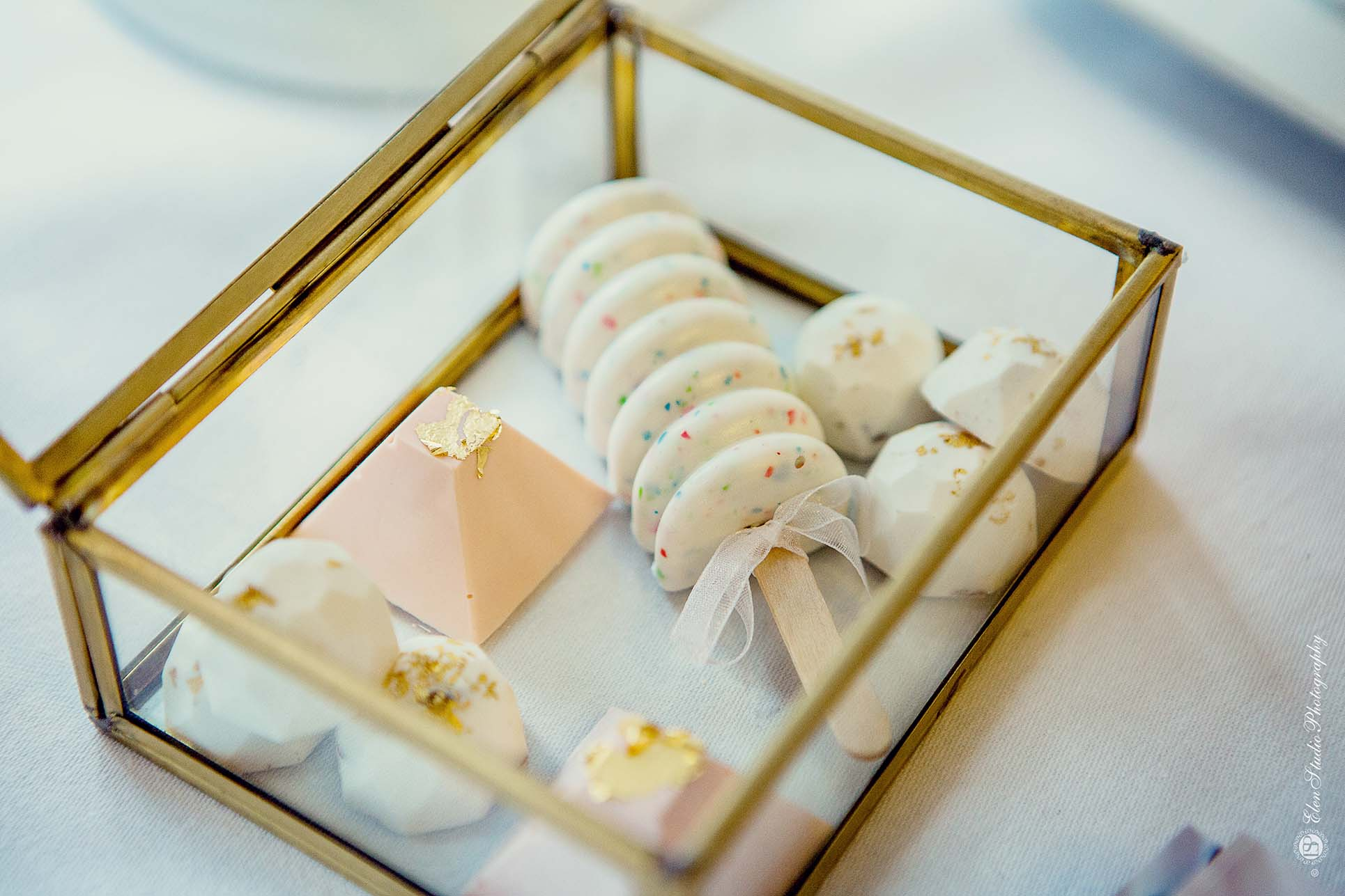 White And Pink Wedding Favours In A Gold Box At Belvoir Castle Wedding Fair By Buckinghams