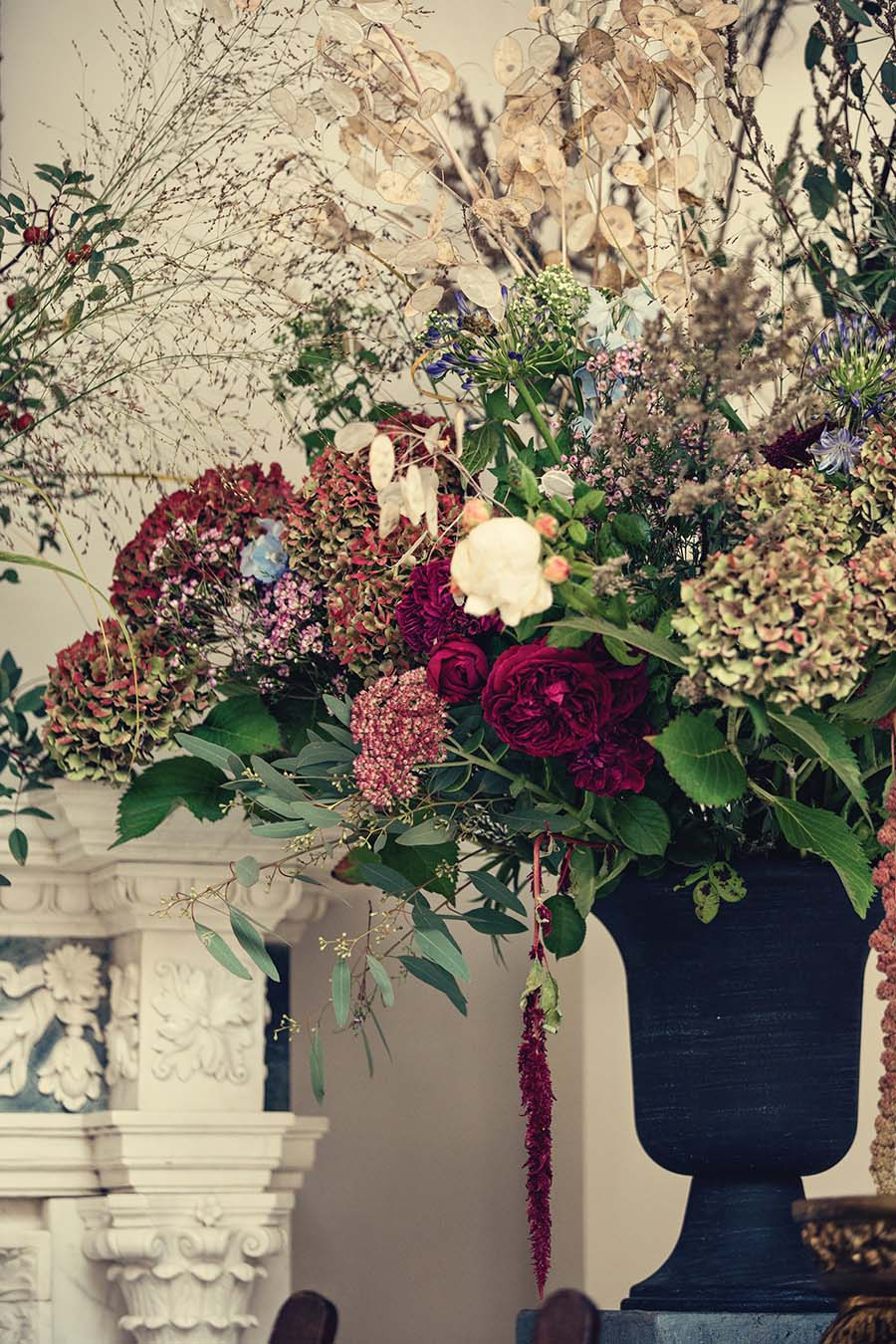 large urn of wedding flowers