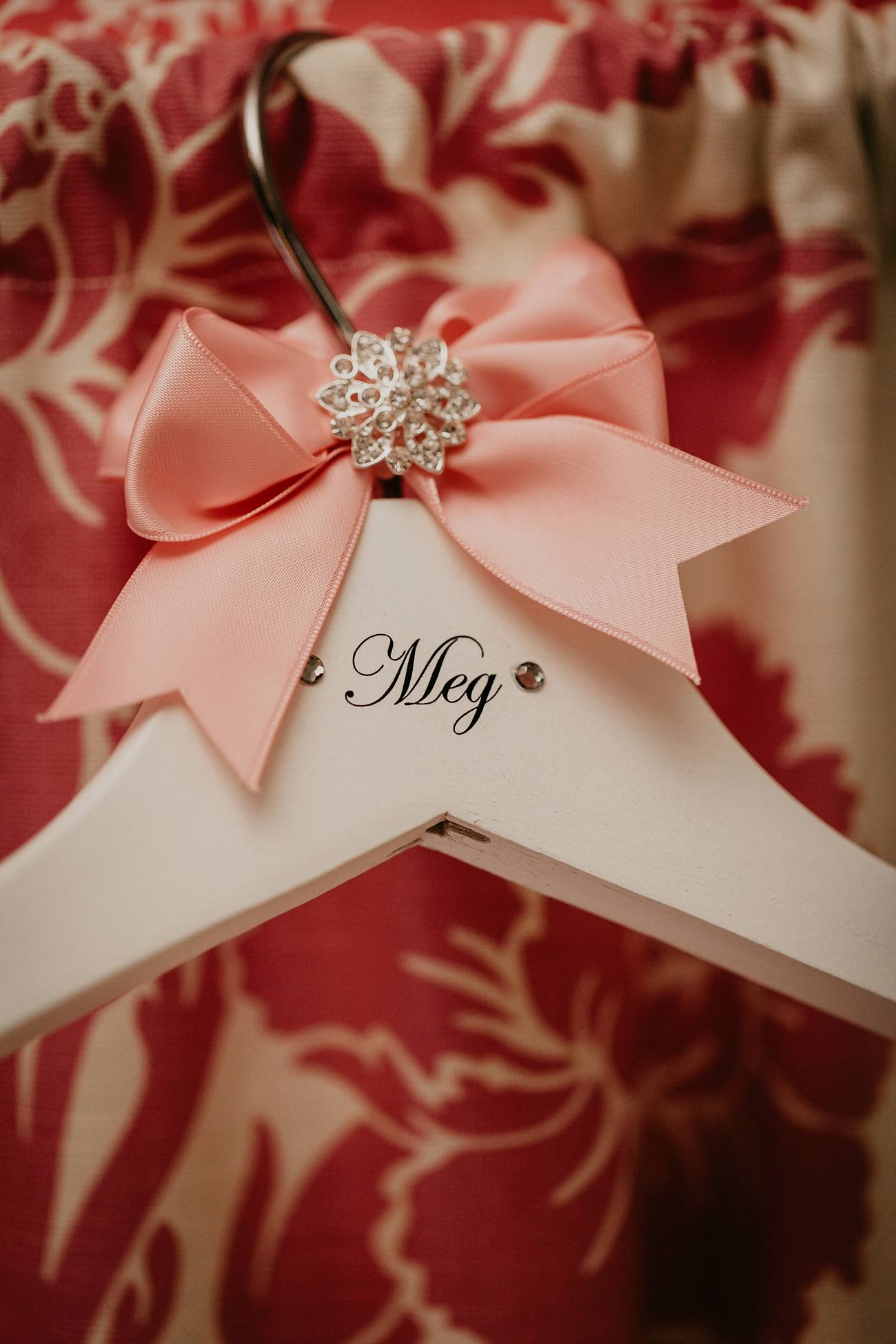 wedding dress hanger with pink box and diamante