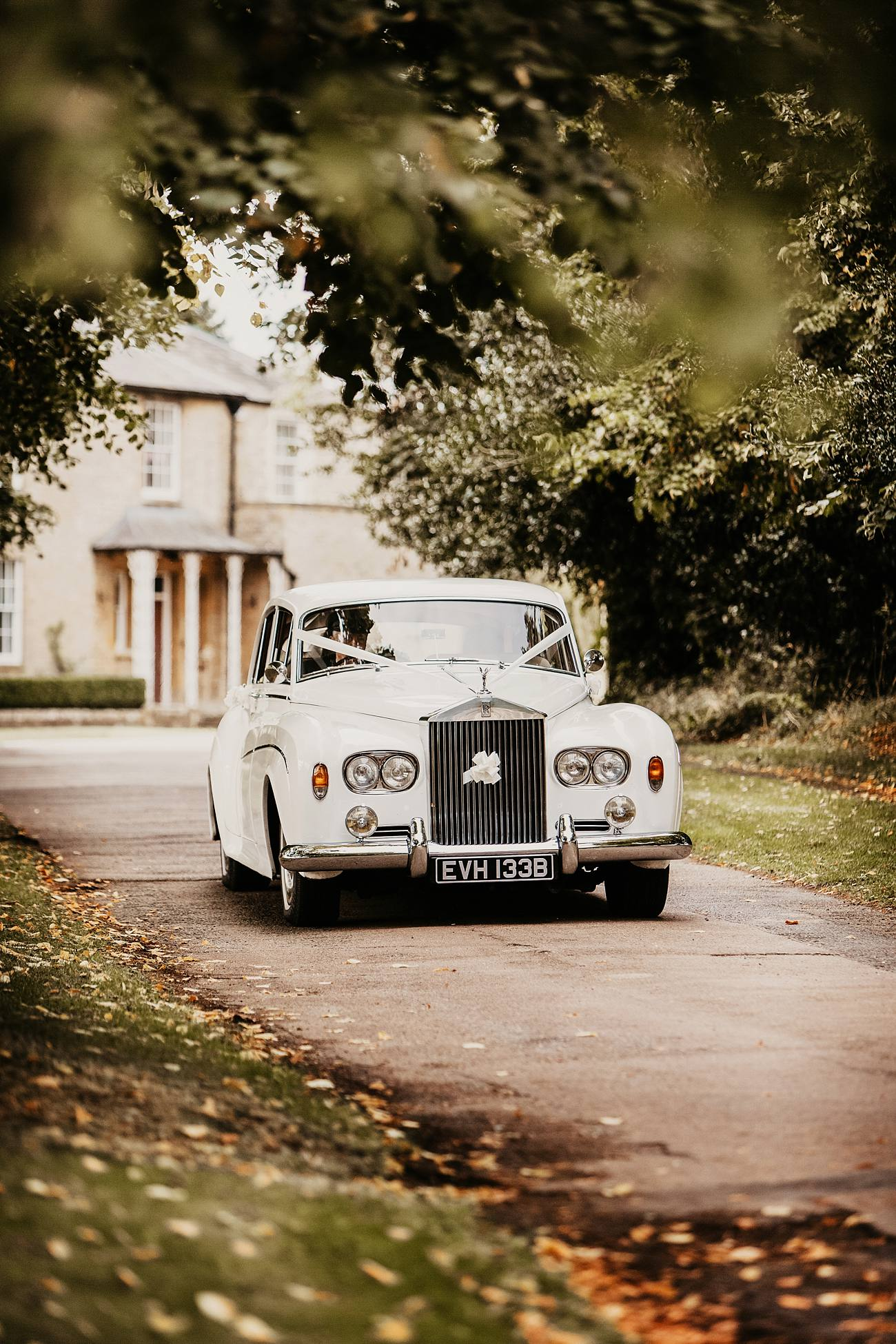 white rolls royce approaching a wedding